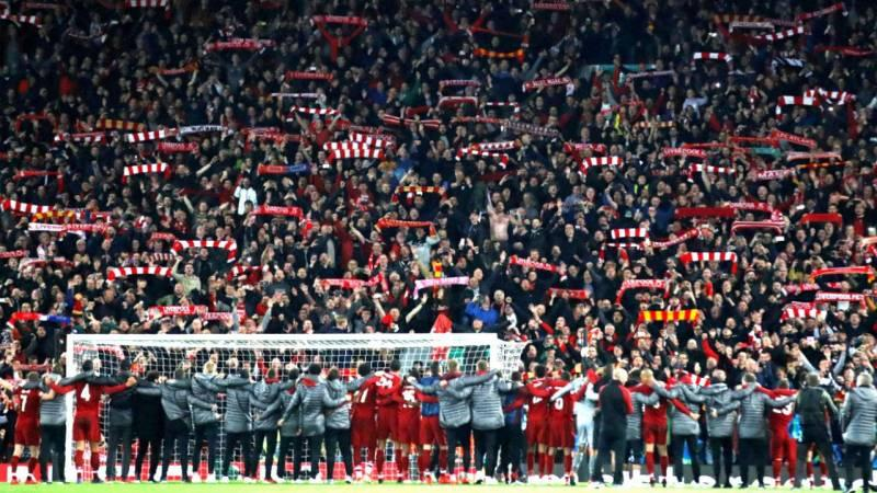 Liverpool FC players celebrating with the fans after their victory against Barcelona in the Champions League Semi-final